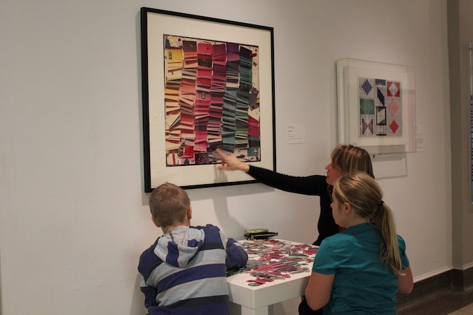 A family works on a puzzle in the Big Idea Gallery: COLOR.
