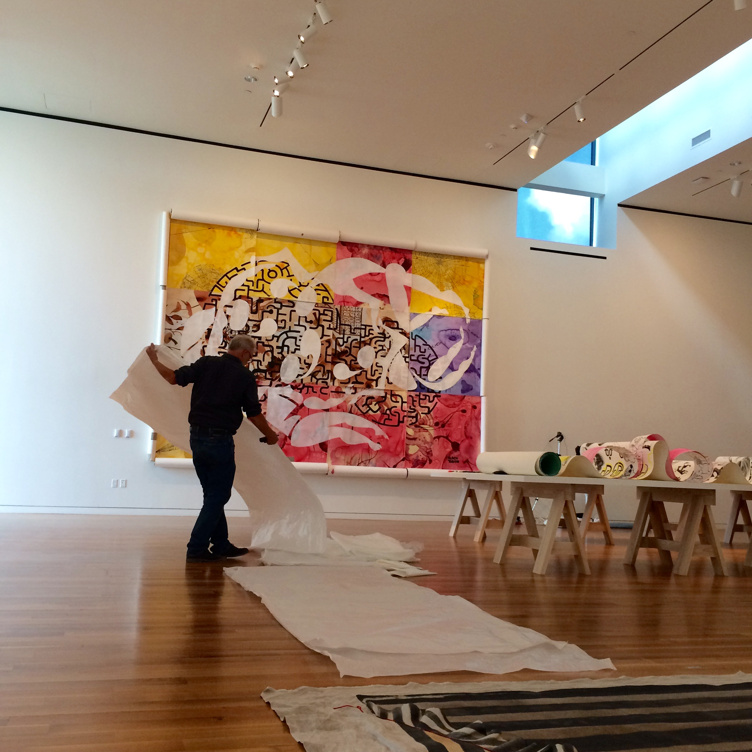 Columbus Museum of Art Exhibition Designer Greg Jones installs Bodies@Work: The Art of Ruben and Isabel Toledo.